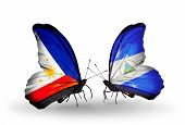 Two Butterflies With Flags On Wings As Symbol Of Relations Philippines And Nicaragua