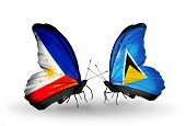 Two Butterflies With Flags On Wings As Symbol Of Relations Philippines And Saint Lucia