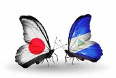 Two Butterflies With Flags On Wings As Symbol Of Relations Japan And Nicaragua