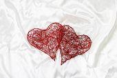 Valentine day red hearts on satin background