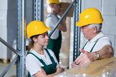 Storage Workers In Warehouse