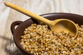 Постер, плакат: Buckwheat Cereal Wooden Spoon