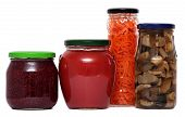 Preserved food in glass jars, isolated on white background. Various marinaded