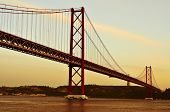 view of the 25 de Abril Bridge and the Cristo Rei in Lisbon, Portugal, with a filter effect