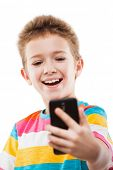 Little smiling child boy hand holding mobile phone or smartphone making selfie portrait photo white isolated