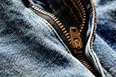 image of denim jeans  - Detail of denim zipper on old worn jeans - JPG