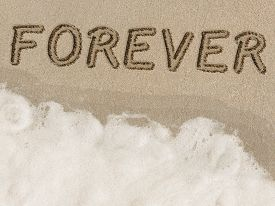 foto of  friends forever  - Forever written in sand next to the shore on the beach - JPG