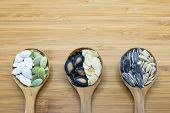 image of sunflower-seeds  - Edible seeds in wood spoon on wood background - JPG