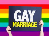 stock photo of gay flag  - Gay Marriage card with rainbow flag on background - JPG