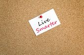 stock photo of feeling better  - Sticky Note On Cork Board Background Live Smarter Concept - JPG