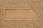 stock photo of sackcloth  - Pointer made from rope with grain rye lying on sackcloth with space for your text - JPG