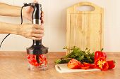 stock photo of blender  - Hands chefs are going to shred red pepper in a blender - JPG