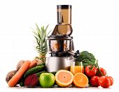 foto of juicer  - Slow juicer with organic fruits and vegetables isolated on white - JPG