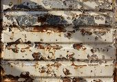 foto of backround  - Old rusted metal wall with worn paint backround - JPG