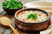 picture of quinoa  - milk soup with potatoes quinoa and peppers on a dark wood background - JPG