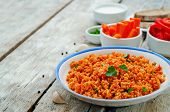 pic of millet  - millet porridge with tomato sauce garlic and parsley on a white wood background - JPG
