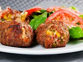 picture of meatball  - Meatballs with corn and cheese shot from below - JPG