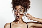 foto of wonderful  - wondered woman with a one eye wathing in magnifying glass - JPG