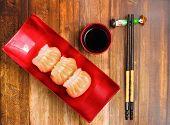 image of siomai  - Vietnam style steamed shrimp dumplings served on a wood table top - JPG