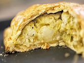 stock photo of leek  - close up of rustic leek and potato pie - JPG