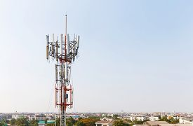 foto of wiretap  - Close up antenna repeater cell tower in city - JPG