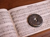 picture of mennonite  - an old antique shaped note song book with a song leader - JPG