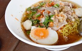 image of boil  - spicy noodle with slice boiled pork and topping boiled egg in bowl - JPG