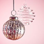 Christmas ornaments on pink