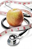 Apple, tape measure and stethoscope