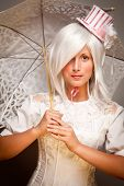 Pretty White Haired Woman With Parasol And Classic Dress