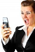 Angry modern business woman shouting on mobile phone