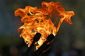 Three Burning Torches