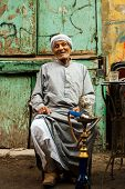 Elderly Egyptian Smoking Sheesha