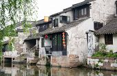 Ancient buildings by the riverside, China