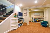 stock photo of basement  - Play room in a white basement living room - JPG