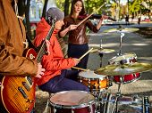Festival music band. Hands playing on percussion instruments in city park. Drums with sticks closeup poster