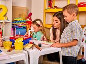 Kids playroom organization of children painting and drawing in kids club. Kindergarten teacher and  poster