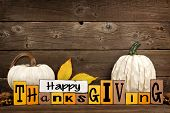 Shabby Chic Happy Thanksgiving Wood Sign With White Pumpkins Against A Rustic Wooden Background poster