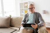 technology, old age, people and lifestyle concept - happy smiling senior man with tablet pc computer poster