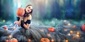 Halloween Witch with a carved Pumpkin and magic lights in a dark forest. Beautiful young surprised w poster