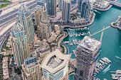 Dubai Marina Canal among hotels in Dubai Marina area and highway in Dubai, UAE poster