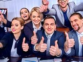 Business people office life of team people are happy with thumb up sitting table. Cabinets with fold poster