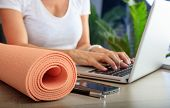 Woman And An Exercise Mat In An Office Background poster