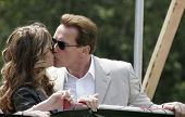 LOS ANGELES - APRIL 2: Maria Shriver kisses husband governor Arnold Schwarzenegger at the softball game before the 'The Benchwarmers' movie premiere at UCLA in Los Angeles, CA on April 2, 2006