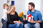 Mothers Or Female Day Concept - Little Son And Father Giving Flowers And Gift To Wife And Mother poster