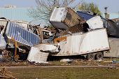 picture of 18 wheeler  - Trucking business hit by tornado and piled on each other - JPG