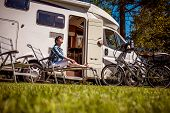 Woman resting near motorhomes in nature. Family vacation travel, holiday trip in motorhome RV, Carav poster