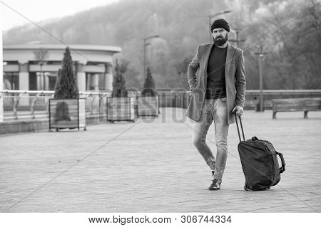 poster of Hipster Ready Enjoy Travel. Looking For Accommodation. Man Bearded Hipster Travel With Big Luggage B