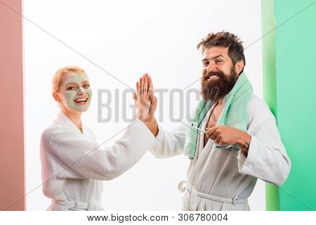 poster of Man Brushing Teeth And Girlfriend With Facial Mask In Bathroom. Good Morning. Couple At Morning. Mor