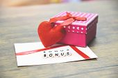 Yearly Bonus Concept / Card Bonus In Paper Envelope With Gift Box Surprise And Red Heart For Encoura poster